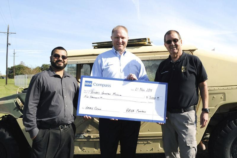 Local bank helps HEARTS restore military Humvee